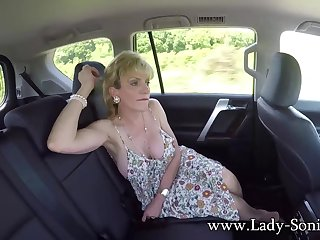 Lady Sonia masturbates in the backseat of a car