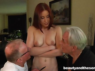Young redhead slut drops on her knees to please two old dicks