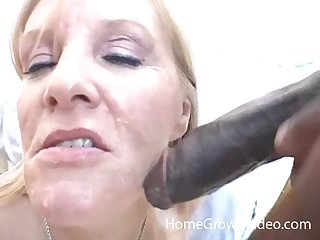 Close up amateur video of a mature wife sucking a massive black dick