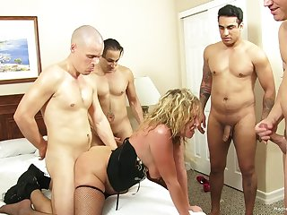 Blonde wife teases her husband's friends and gets gangbanged