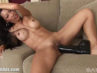 Amazing mature with the perfect fake tits masturbates with a large dildo